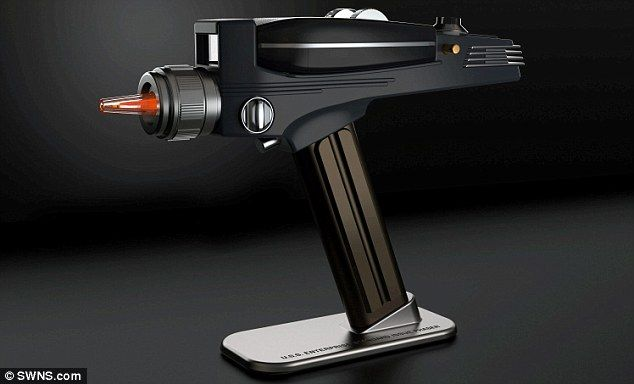The replica phaser (pictured) was built by The Wand Company and goes on sale in November. ...