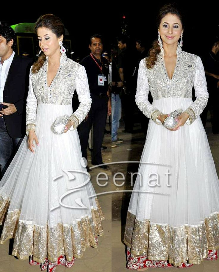 Urmila white flared anarkali gown   1. White net anarkali with golden color border 2. White yoke with intricate silver embroidery all over 3. Red shantoon border with zari and stone hand work 4. Comes with white net dupatta