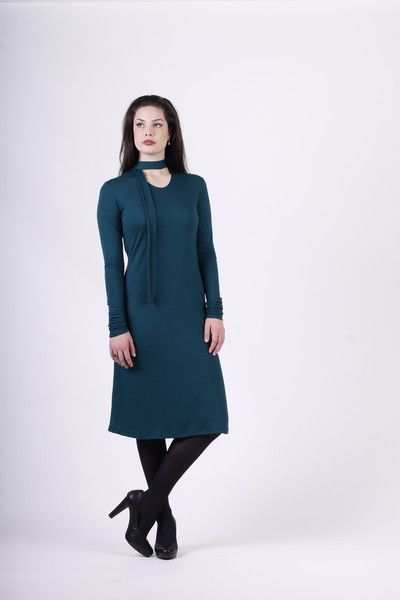 Merino wool dress with long scrunchy sleeves that fit any length and a neck tie that can be worn lots of different ways. Proudly made in New Zealand