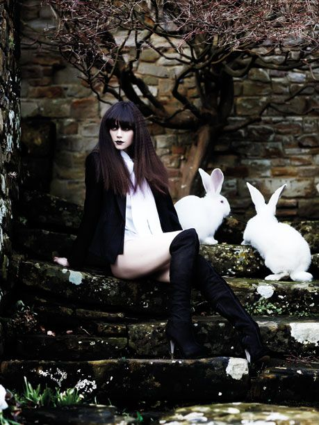 White rabbits pose with model Lilah Parsons