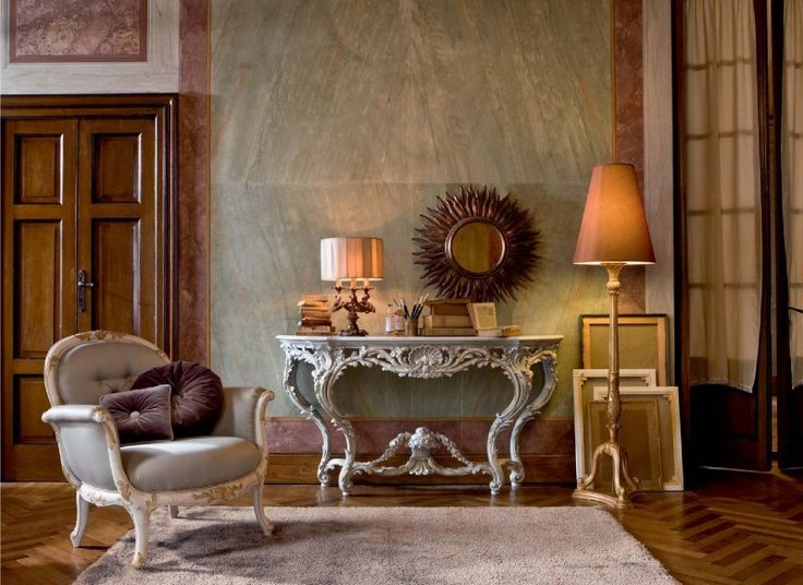 Luxurious interior featuring hand crafted Italian home furnishings  carved  console table  sunburst mirror. 633 best Luxury Furniture images on Pinterest