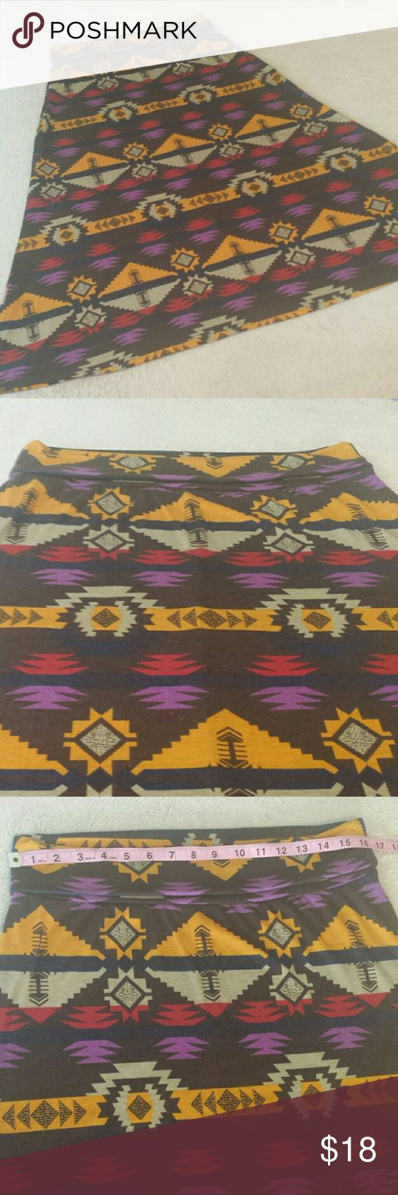 NWT. Caren Sport Aztec Print Skirt. Size 1X New with tag skirt by Carenc Sport. Comfortable and pretty with an Aztec print. 92% Polyester, 8% Spandex. See pics for approx measurements. No flaws. Size 1X. Caren Sport Skirts