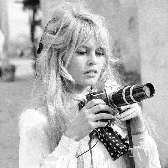 life:  Brigitte Bardot taking pictures on the set of Viva Maria in 1965. (Ralph Crane—The LIFE Picture Collection/Getty Images) #LIFElegends