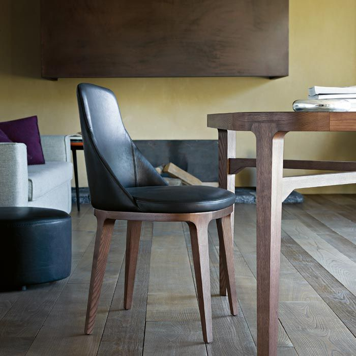 LEMA   LUCY, Elegant and refined, it stands out for the solid wood structure and cosy and harmonious forms of the seat proposed with leather upholstery with busted out stitching that underscore Lema's tailoring approach. The comfortable padding adds to the softness.