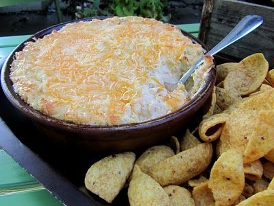 "Chicken Enchilada Dip. Another pinner wrote, ""I make this for parties all the time, and it's always a HUGE hit!"""
