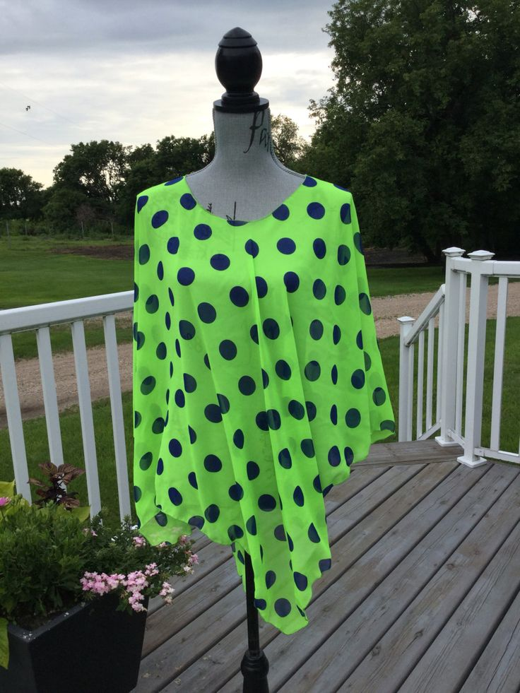 Super cute lime green with royal blue dots chiffon wrap is great over a tank top, camisole or as a swimsuit coverup.  Side slits allow for free arms to wear under a jacket!  One size fits any woman up to size 24