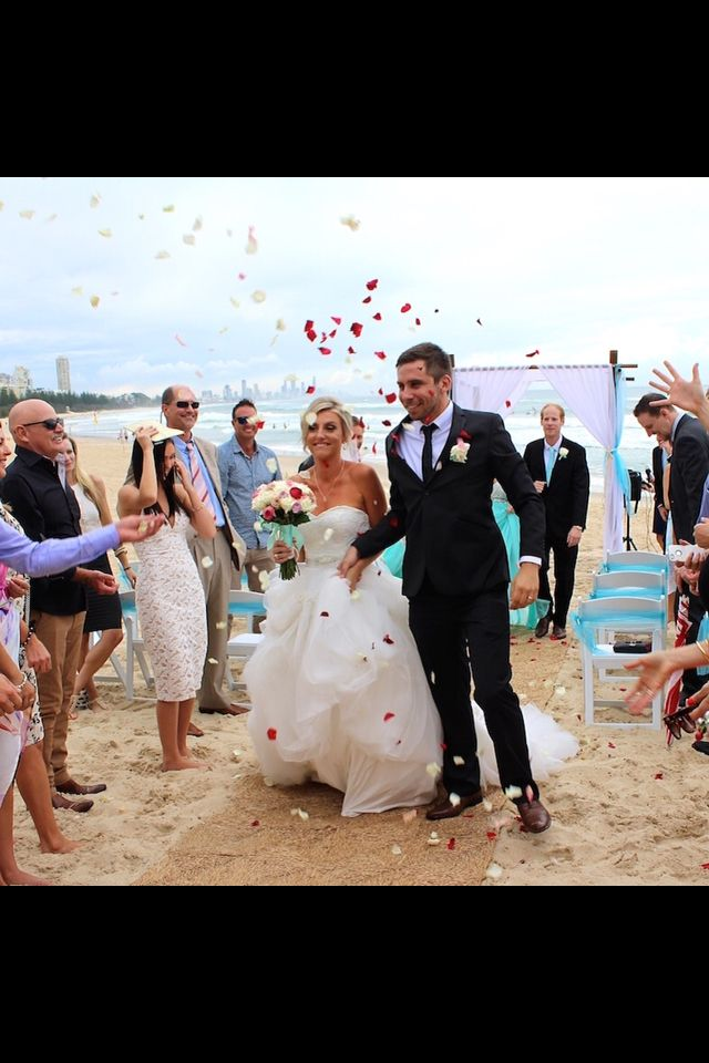 Petal toss for the newlyweds Bianca & Gavan at Burleigh Beach Styling by www.breezeweddings.com.au #burleigh #beach #heads #wedding #beachwedding #weddingaustralia #goldcoastwedding #bambooarbor #chuppa #breezeweddingsaustralia #petal #toss #happily #married #end #ceremony #congratulations #австралия #свадьба #свадебная #церемония #на#пляже #лепестки #роз #молодожены #newlyweds #aqua #blue #theme