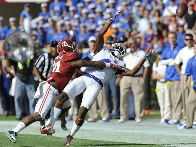 Alabama defensive back Geno Smith (24) breaks up a pass intended for Florida's Andre Debose (4) at Bryant Denny Stadium in Tuscaloosa, Ala. on Saturday September 20,  2014.
