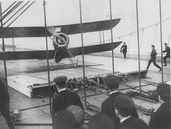 A Sopwith pup aircraft landing on the deck of the British Aircraft Carrier Furious