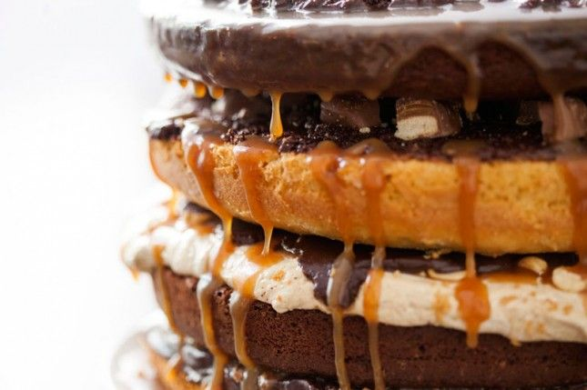 Four layers of Twix, Snickers, Heath Bars, and Rolos in one cake! INTENSE!
