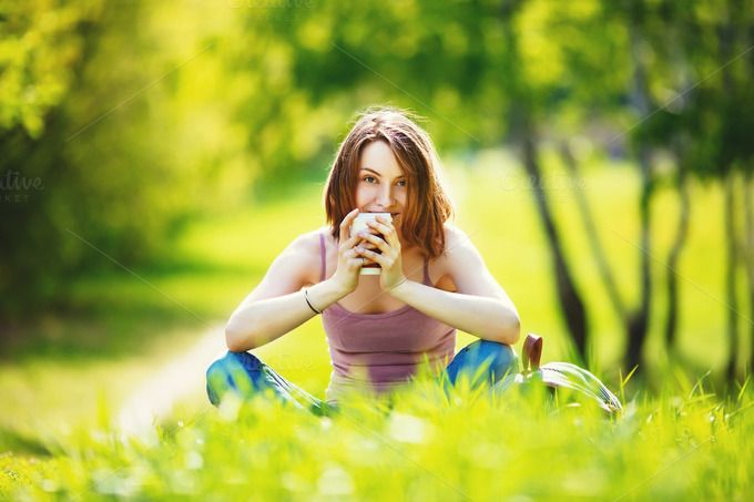 Girl sitting at the grass in park by odpium on Creative Market