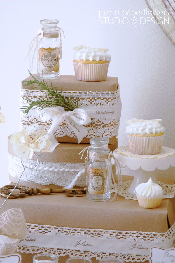 Love the lace on the boxes wrapped in craft paper.