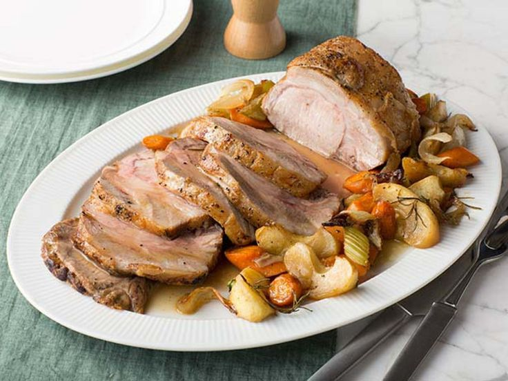 Roast Pork Loin with Apples - Roasted with sweet, sliced apples and veggies, then finished with an aromatic apple cider sauce, this juicy pork loin is a fan-favorite recipe that embodies the fall season through and through. http://www.foodnetwork.com/recipes/food-network-kitchens/roast-pork-loin-with-apples-recipe.html