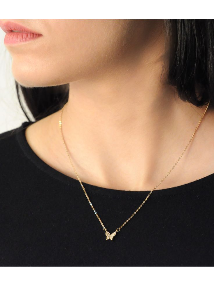 Flutter necklace in Gold -  INR 1,199 - This delicate necklace features a butterfly pendent set with cubic zirconias and is polished in 18K Gold. The pendent is held in a delicate golden link chain and is great for layering or wear on its own. To ensure the look of your jewellery stays intact, avoid contact with liquids and perfumes.