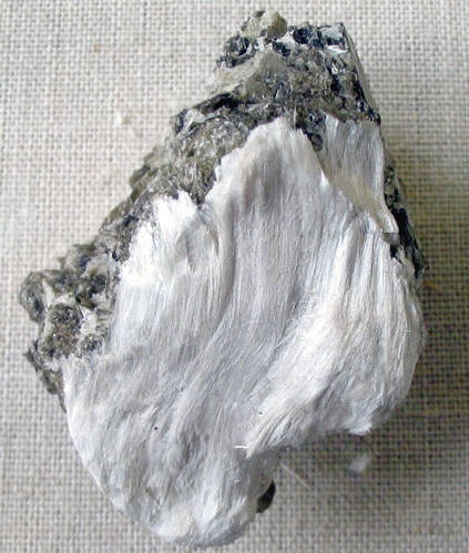 TEXTILES OF MINERAL ORIGIN - these may be made from substances including asbestos, metals etc. Asbestos is a silicate mineral with long, fibrous crystals.