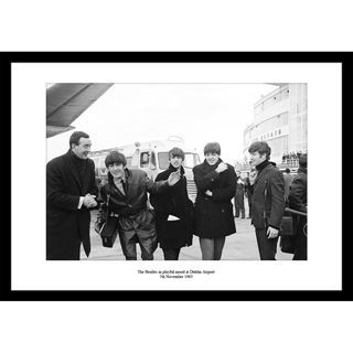 This photo was taken on The Beatles only visit to Ireland as the came to play a show in the Adelphi Cinema, Dublin. As senn in this photo The Beatles were in a playful mood as they landed in Dublin Airport.