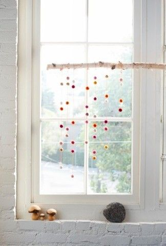 Would be very cute in kitchen window or baby's room - glass beads hanging from a beautiful branch.