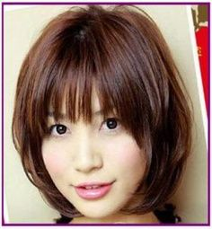 Medium length layered hairstyle with thick bangs