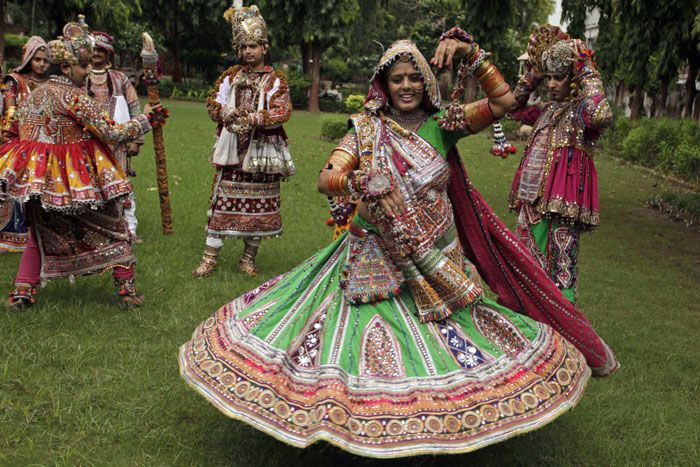 Dancers dressed in traditional attire take part in rehearsals for the 'Garba' dance ahead of nine-day Navratri festival in Ahmedabad on Sunday.