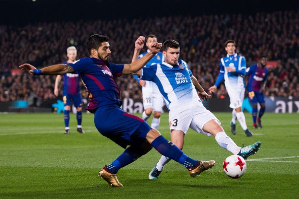 Luis Suarez of FC Barcelona plays the ball under pressure from Aaron Martin of RCD Espanyol during the Spanish Copa del Rey Quarter Final Second Leg match between FC Barcelona and RCD Espanyol at Camp Nou stadium at Camp Nou on January 25, 2018 in Barcelona.