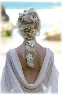 Long hair beach hairstyle with flowers for you wedding.