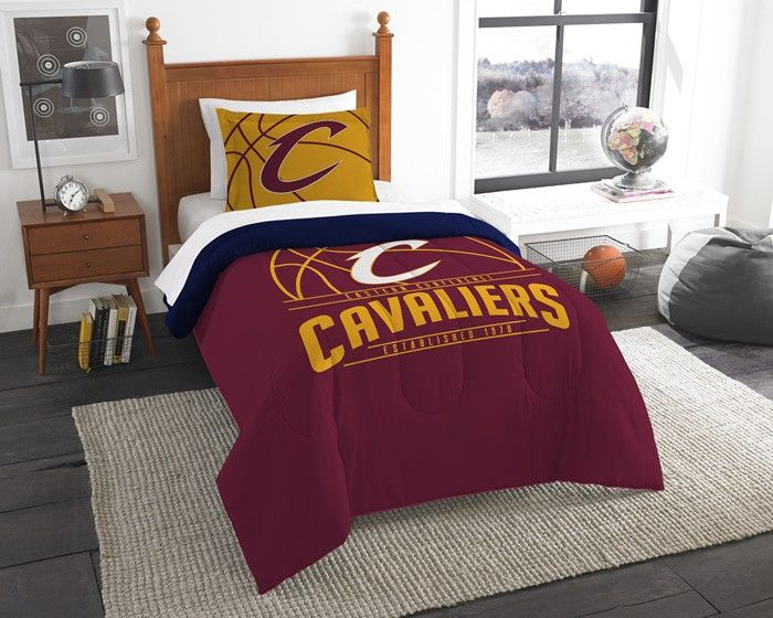 Cleveland Cavaliers NBA Reverse Slam Twin Comforter and Sham Set. Includes 1 Sham and 1 Twin Comforter. Visit SportsFansPlus.com for Details.