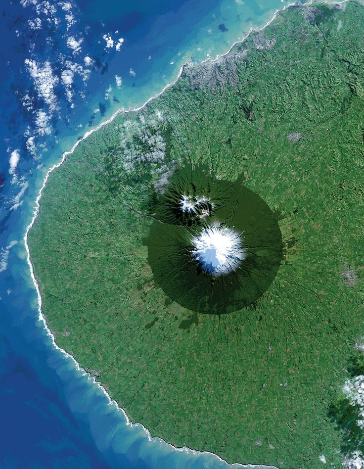 Exploring the World's Protected Areas from Space | NASA.  Egmont National Park in New Zealand shows the benefits and limitations of protected areas. In this Landsat 8 image acquired on July 3, 2014, the park, with Mt. Taranaki at its center, was established in 1900. This isolated island of protected forest (dark green areas) is surrounded by once-forested pasturelands (light and brown green).