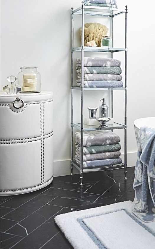 Stylish and contemporary, the Elizabeth Hamper is great for modern settings. Designed to help you de-clutter and organize, the faux-leather, half-round shape sits flush against walls or cabinet closets.