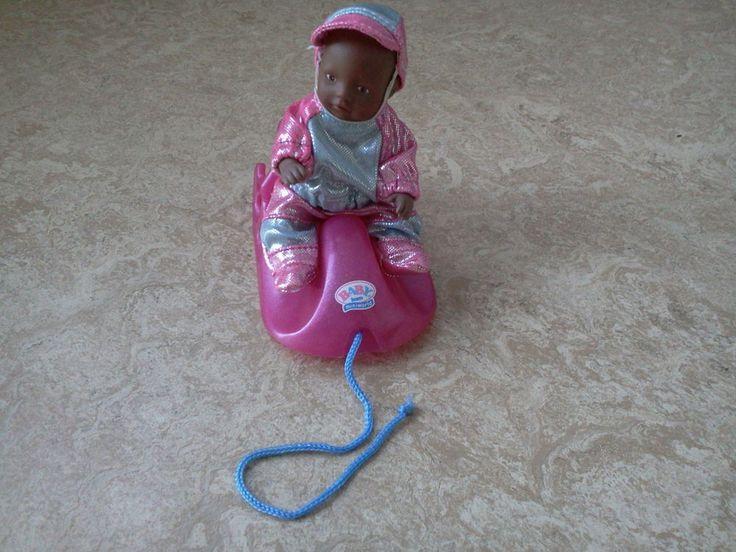 Mini Baby Born Puppe mit Schlitten
