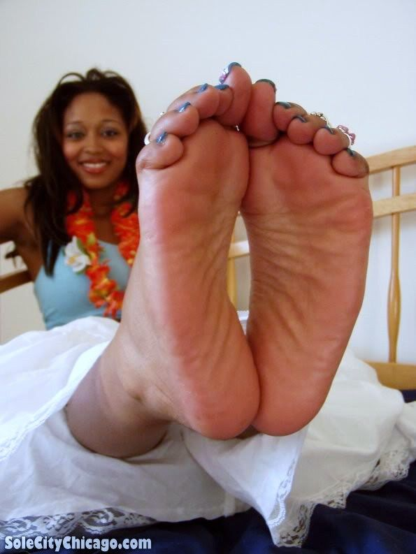 in Ebony face soles feet