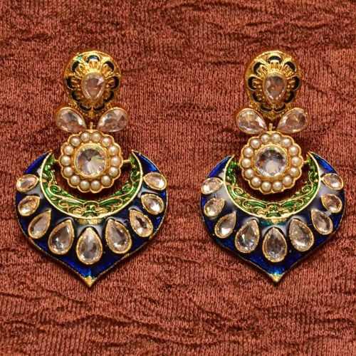 Anvi's elegant blue enamel work and meenakari earrings with uncut stones