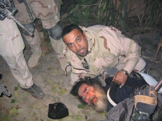 Terrorist Saddam Hussein at the moment of capture by US troops, December 13, 2003.