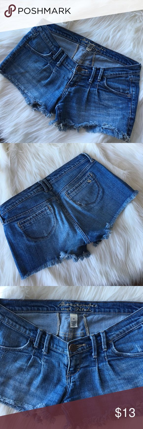 Abercrombie and Fitch frayed hem jeans shorts Abercrombie and Fitch jeans shorts- low rise, stretch,frayed hem, naturally distressed, size 0, inseam 2.5' Abercrombie & Fitch Shorts Jean Shorts