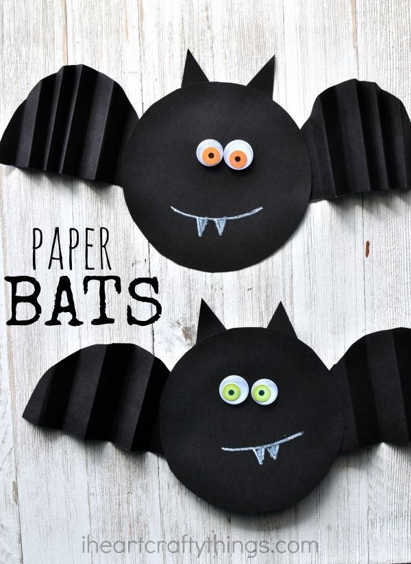 This simple accordion fold paper bat craft. Cut 2 black circles. Accordion fold one circle & cut in half for wings. Cut 2 triangles for ears. Glue on google eyes. Use white crayon or chalk for mouth & fangs.