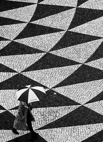 Umbrella and Portuguese Traditional Pavement by Miguel Lopes.