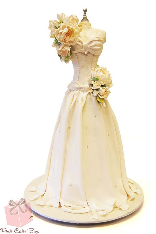 This amazing Wedding Dress Cake stands at just over 5 feet tall!! What a sugar high! he he he!! So elegant! From the spectacular team at Pink Cake Box ❤ http://blog.pinkcakebox.com/3d-sculpted-bridal-bodice-2014-01-17.htm ❤ Wedding Dress Cake ❤ Gown Cake ❤ Bridal Shower Cake ❤ Life Size Cake ❤