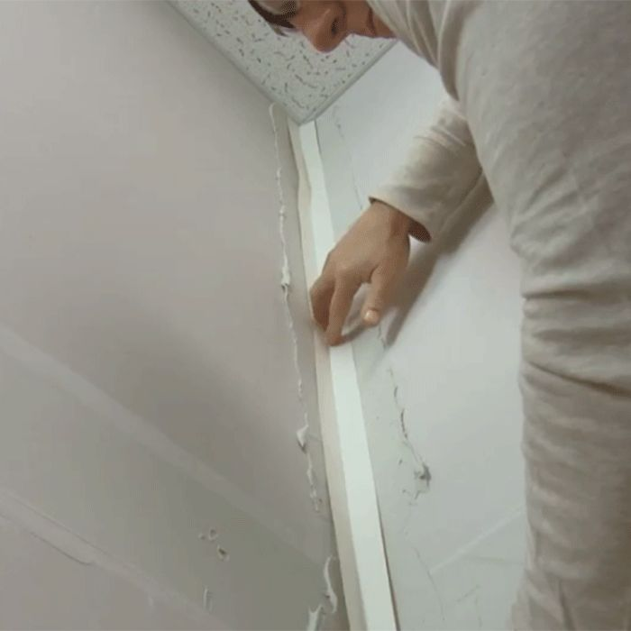 Pressing Paper Tape Into Inside Corner Coated With Joint