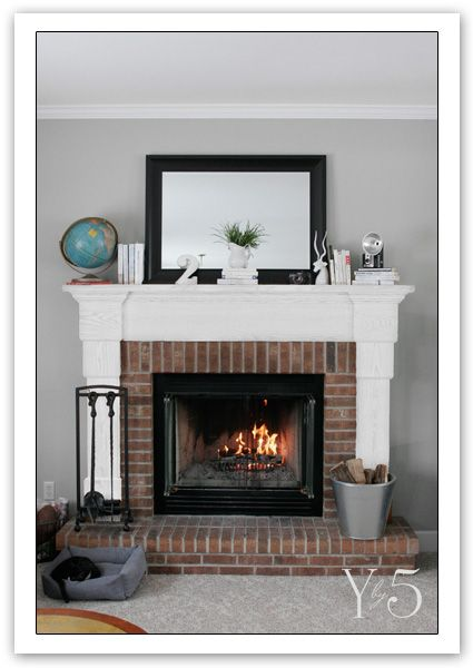 grey walls white mantle natural brick fireplace the