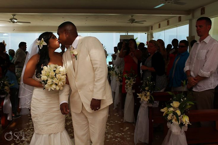 """Cancun wedding at the Gran Caribe Real / Hyatt Zilara, newlyweds share a sweet kiss in the """"Our Lady of Guadaloupe Chapel"""".  Mexico wedding photographers Del Sol Photography"""