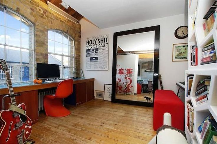 A cool monochrome palette with vivid shots of red compliment exposed brick walls in study of The Flag Store, London