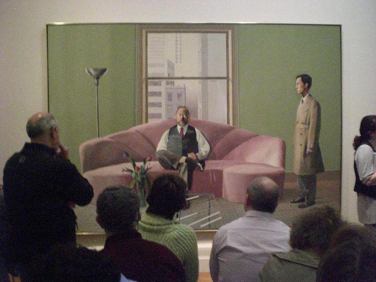 Главным героем портретов Хокни стал его многолетний друг Генри Гельдзалер, куратор искусства ХХ века в музее Метрополитен и ключевая фигура нью-йоркского культурного пейзажа. Гельзалер ярко одевался и был большим позером. На двойном портрете «Генри Гельдзалер и Кристофер Скотт» куратор вальяжно развалился на диване в центре картины, в то время как его одетый в плащ любовник не то входит, не то выходит из комнаты. Сцена почти библейская, напоминающая о Благовещении.