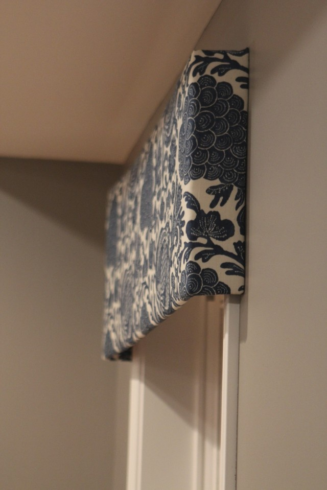 add a piece of fabric stripping to top of curtain, doesn't even need to be as squared off as this one, but its nice and simple and can be done with a staple gun
