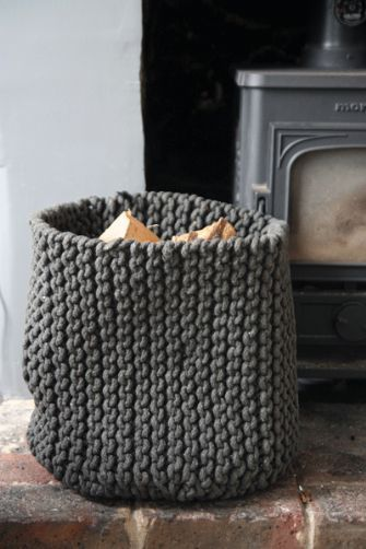 No pattern but I could crochet a circular base and knit the sides?