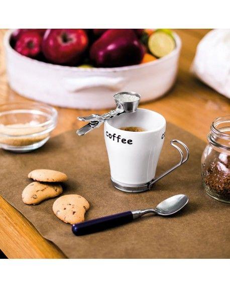 CLIP ONZA La giusta dose in un clip! Puoi fissarla direttamente alla tazza per misurare la quantità d'infuso o di zucchero che ti serve oppure fissarla sul bordo di qualsiasi contenitore o vicino alla macchina dell'espresso. Niente più bilance… basta una clippe!