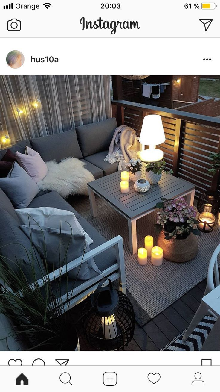 Small balcony with cozy seating area, candles and lanterns. – lamodademama
