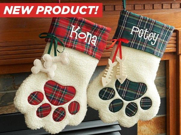 Share the holiday spirit with your family pet! Perfect for this upcoming season, these festive hanging Christmas stockings feature a red or green plaid cuff and dog or fish bone hanging accents.