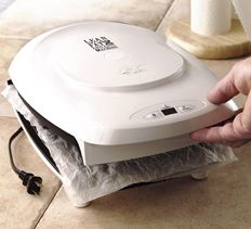 Right after using the Grill or waffle iron, unplug it and place a wet double-sheet of paper towel between the lid and the surface. The leftover heat causes the towel to steam and clean the grill. Wiping it dry with another paper towel is all that's needed.