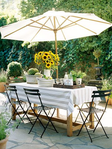 Love this setting for an outdoor meal...maybe a permanent kind of picnic place. Like the mix of metal chair with a wood table. LJH
