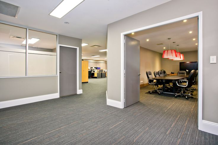 Dunham and Company main office space + boardroom. Carpet - Interface Alliteration - Hemlock/Earth Rust; custom board table.