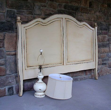 2-toned and distressed headboard.  Maybe a lighted tone of your wall color in the center?